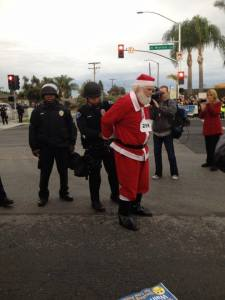 2013-11-29-Santa Arrested Protesting Low Wages at WalMartjpg